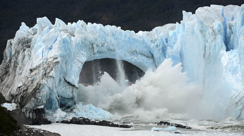 In this Thursday, March 10, 2016 photo, ice breaks off the Perito Moreno Glacier in Lake Argentina at Los Glaciares National Park near El Calafate in Argentina's Patagonia region. The massive natural monument in the province of Santa Cruz periodically advances over the lake, and then breaks off. The glacier last ruptured in March 2012. (AP Photo/Francisco Munoz)